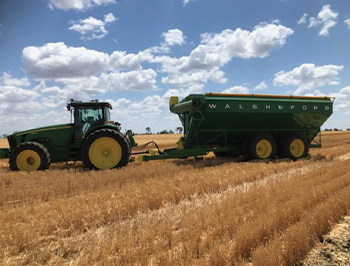 Grain Cart Working in the field at wheat harvest
