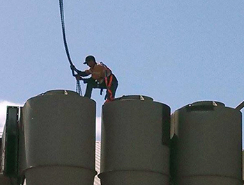 Worker erection silos on a cotton gin project