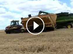 Manure Spreader in the chaser bin configuration loading on the run.